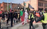 تصاویر: حمله پلیس آمریکا به تجمع انتخاباتی با اسپری فلفل!
